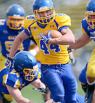 BROOKINGS, SD - APRIL 26:  Brady Mengarelli #44 from South Dakota State's offense breaks loose past Nick Farina #24 from the defense during their spring game Saturday at Coughlin Alumni Stadium in Brookings. (Photo by Dave Eggen/Inertia)