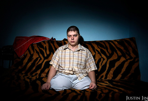 Portrait of Russian army hazing victim Andrei Sychyov at home in Yekaterinburg..On New Yearís Day in 2006 in the barracks of the Chelyabinsk Tank Academy, a sergeant, possibly drunk, meted out punishment to Pvt. Andrei S. Sychyov..Private Sychyov was forced to squat for three and a half hours. When he complained, as the pain worsened, the sergeant stomped on his ankle twice..Private Sychyov suffered injuries that resulted in infection, then in the amputation of his both legs, a finger, and genitals. .His case became the biggest scandal to reflect the state of Russia's army and the country's human rights situation.