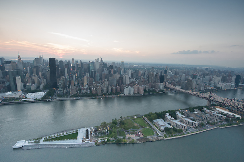 NEW YORK - AUGUST 2: Aerial view of Roosevelt Island on  August 2, 2012 in New York City. The southern tip of Roosevelt Island houses Four Freedoms Park, which opened to the public on October 24, 2012.