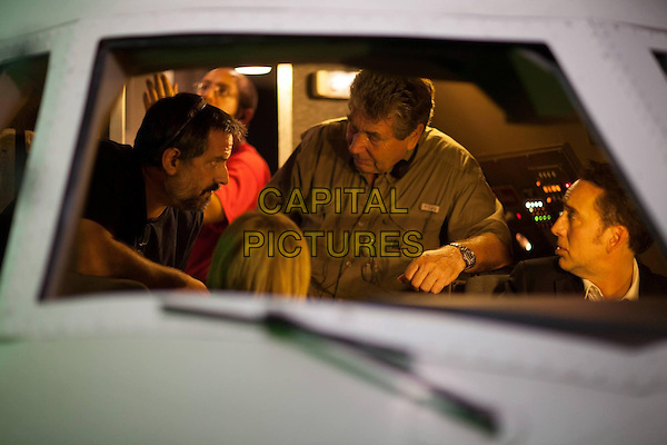 Vic Armstrong (director), Nicolas Cage<br /> on the set of Left Behind (2014) <br /> *Filmstill - Editorial Use Only*<br /> CAP/NFS<br /> Image supplied by Capital Pictures