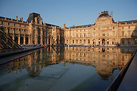 PARIS, FRANCE - AUGUST 25 : A general view of the Sully wing of the Louvre Museum on August 25, 2007 in Paris, France. Originally a 12th century fortress the Louvre Palace rebuilt and expanded many times, was opened to the public as a museum during the French Revolution.To the left is the corner of the pyramid, designed by the American architect I M Pei, and opened in 1989, plus one of the three smaller pyramids. The old palace is reflected in one of the seven granite pools, lit by the afternoon light. (Photo by Manuel Cohen)