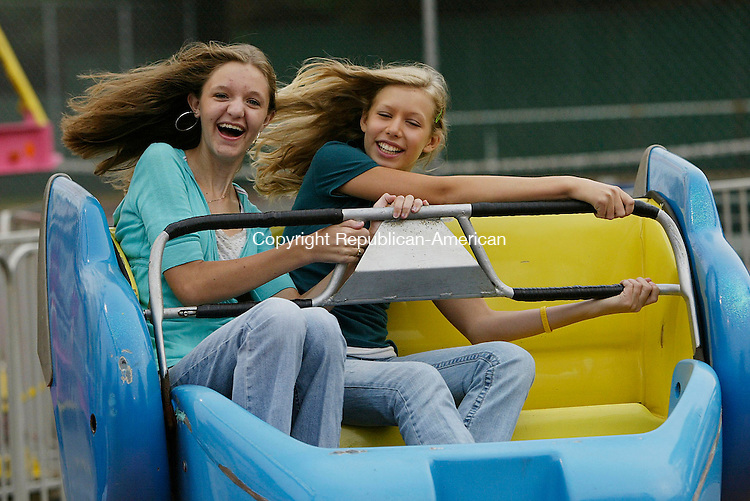 TORRINGTON, CT 9/13/07- 091407BZ06- Kailey Stewart, 13, and her friend Gevony Steele (CQ), 12, both of Torrington, ride the &quot;Sizzler&quot; at the Northwest Connecticut Community Carnival at Fuessenich Park in Torrington Friday.  <br /> Jamison C. Bazinet Republican-American
