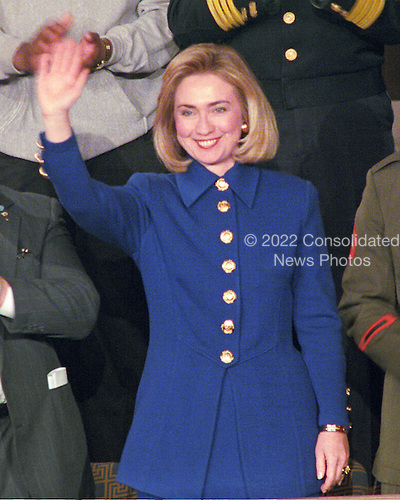 First lady Hillary Rodham Clinton waves from the gallery as United States President Bill Clinton delivers his State of the Union Address to a joint session of the US Congress in the US House Chamber of the US Capitol in Washington, DC on January 24, 1995.<br /> Credit: Ron Sachs / CNP