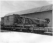 C&amp;TS pile driver OB next to warehouse in Chama yard.<br /> C&amp;TS  Chama, NM  Taken by Payne, Andy M. - 1/31/1971
