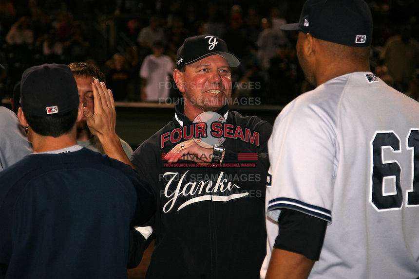 September 4, 2009:  Manager Dave Miley of the Scranton Wilkes-Barre Yankees congratulates Humberto Sanchez after a game at Frontier Field in Rochester, NY.  Scranton is the Triple-A International League affiliate of the New York Yankees and clinched the North Division Title with a victory over Rochester.  Photo By Mike Janes/Four Seam Images