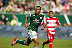 04/14/2011 - Rodney Wallace keeps his eye on the ball moving down field as the Portland Timbers play FC Dallas during the Portland Timbers' second MLS home match at Jeld-Wen Field Sunday.  ..Photo by Christopher Onstott