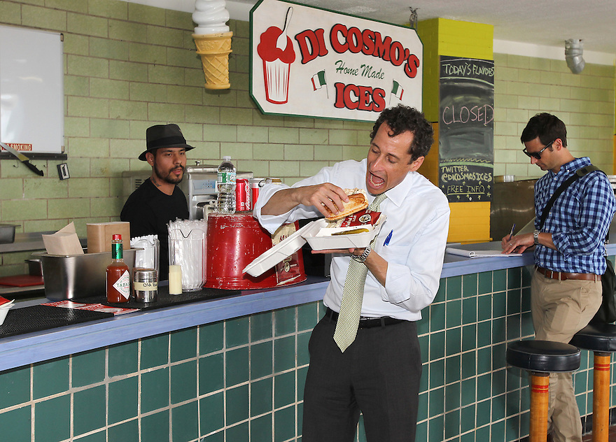 Anthony Weiner has a crab roll and chips from the Lobster Joint while having lunch on the Far Rockaway Beach Boardwalk on Wednesday, August 14, 2013 in New York. (AP Photo/ Donald Traill)