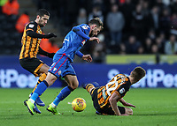 Bolton Wanderers' Christian Doidge competing with Hull City's Evandro Goebel and Markus Henriksen in the penalty area<br /> <br /> Photographer Andrew Kearns/CameraSport<br /> <br /> The EFL Sky Bet Championship - Hull City v Bolton Wanderers - Tuesday 1st January 2019 - KC Stadium - Hull<br /> <br /> World Copyright © 2019 CameraSport. All rights reserved. 43 Linden Ave. Countesthorpe. Leicester. England. LE8 5PG - Tel: +44 (0) 116 277 4147 - admin@camerasport.com - www.camerasport.com