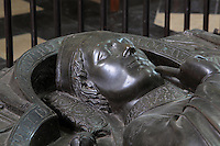 Tomb of Gisant d&rsquo;Evrard de Fouilloy, bishop of Amiens 1211-22, who laid the first stone of the cathedral in 1220, bronze, 13th century, <br /> in the Basilique Cathedrale Notre-Dame d'Amiens or Cathedral Basilica of Our Lady of Amiens, built 1220-70 in Gothic style, Amiens, Picardy, France. The bishop's head rests on a cushion and his eyes are open, awake to eternal life. His right hand gestures in blessing and his left hand helds his crozier (now lost). Amiens Cathedral was listed as a UNESCO World Heritage Site in 1981. Picture by Manuel Cohen