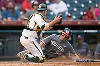 Caleb Ramsey #28 of the Houston Cougars slides into home plate ahead of the tag by catcher Gregg Glime #13 of the Baylor Bears in the 2009 Houston College Classic at Minute Maid Park February 27, 2009 in Houston, TX.  The Bears defeated the Cougars 3-2. (Photo by Brian Westerholt / Four Seam Images)