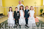 Pupils from Dromnacurra NS, Causway whom received communion at Causway Church on Saturday last. Lisa & Liam Barrett, Ciara O'Hanlon, Daniel Burke & Debra canty and  Fr. Brendan Walsh at the back.