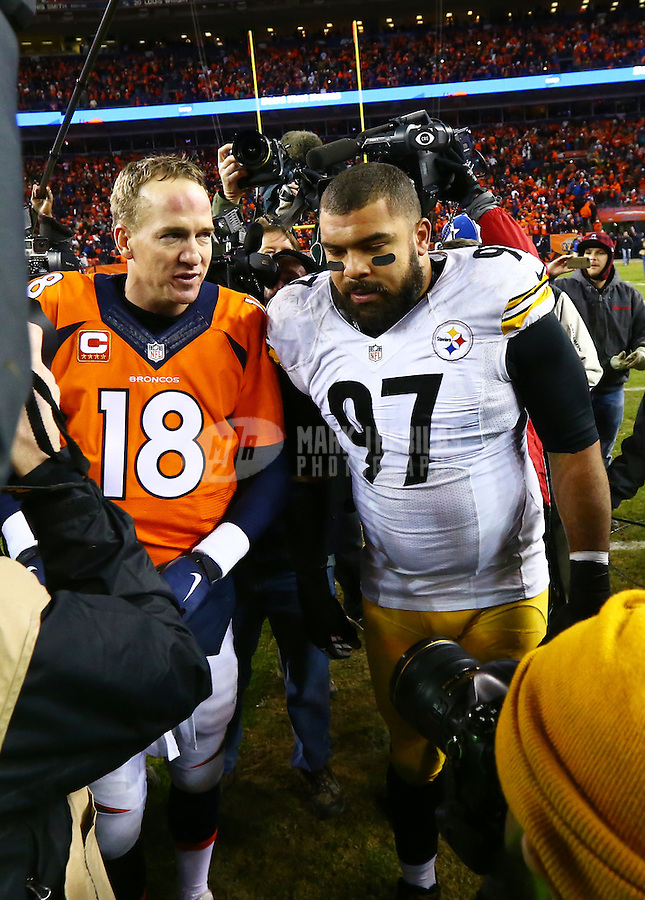 Jan 17, 2016; Denver, CO, USA; Pittsburgh Steelers defensive end Cameron Heyward (97) greets Denver Broncos quarterback Peyton Manning (18) following the AFC Divisional round playoff game at Sports Authority Field at Mile High. Mandatory Credit: Mark J. Rebilas-USA TODAY Sports