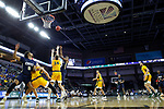 SIOUX FALLS, SD - MARCH 8: Emmanuel Nzekwesi #23 of the Oral Roberts Golden Eagles shoots against the defense from North Dakota State Bison at the 2020 Summit League Basketball Championship in Sioux Falls, SD. (Photo by Richard Carlson/Inertia)