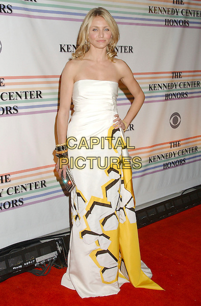 CAMERON DIAZ.30th Kennedy Center Honors Recipients honored for lifetime achievement in the performing arts held at the Kennedy Center for the Performing Arts, Washington, D.C. .USA, 02 December 2007..Full length strapless white yellow print printed dress bangles bracelets hand on hip clutch bag.CAP/ADM/LF.©Laura Farr/AdMedia/Capital Pictures.
