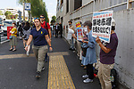 People against the closing of Tokyo's Tsukiji Wholesale Fish Market protest outside the fish market's main gate on October 10, 2018, Tokyo, Japan. Tokyo's iconic fish market closed its doors for the last time on October 6 for a move to a newly created facility, ''The Toyosu Fish Market,'' which will start operating on October 16. The wholesale fish market in Tsukiji first opened in the mid-1930s and was one of the Japanese capital's most popular destinations for international tourists. (Photo by Rodrigo Reyes Marin/AFLO)