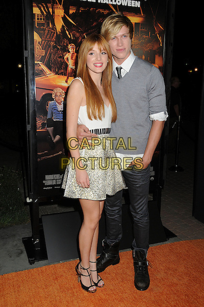 "Bella Thorne, Tristan Klier.""Fun Size"" Los Angeles Premiere held at Paramount Studios, Los Angeles, California, USA..October 25th, 2012.full length grey gray jumper sweater couple white top gold green skirt pattern print black jeans denim.CAP/ADM/BP.©Byron Purvis/AdMedia/Capital Pictures."