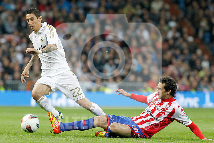 Real Madrid's Angel Di Maria (l) and Sporting de Gijon's Miguel Angel de las Cuevas during La Liga match.April 14,2012. (ALTERPHOTOS/Acero)