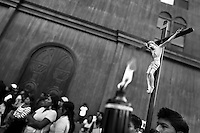 Catholic followers carry a small figure of Jesus Christ crucified on the cross during the annual Holy Week ritual (Lavado de la cruz) in Santa Elena, Ecuador, 3 April 2012.