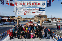 A portion of the mushers who finished the 2015 Iditarod as of 2pm on Saturday March 21st pose at the finish line in Nome for a group photo<br /> <br /> (C) Jeff Schultz/SchultzPhoto.com - ALL RIGHTS RESERVED<br />  DUPLICATION  PROHIBITED  WITHOUT  PERMISSION