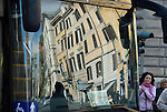 reflection of buildings of rome, italy in the window of a tourist coach