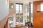 Floor-to-ceiling windows let the light flood into the living room of this contemporary island home. This image is available through an alternate architectural stock image agency, Collinstock located here: http://www.collinstock.com
