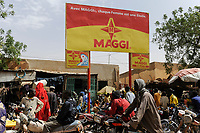 NIGER Zinder, market, advertisement billboard for Maggi bouillon cube a brand of swiss multinational company Nestle