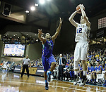 SIOUX FALLS, SD - NOVEMBER 30:  Keaton Moffitt #12 from South Dakota State University spots up for a jumper over Brian Greene Jr. #14 from Florida Gulf Coast in the first half of their game Sunday afternoon at the Sanford Pentagon in Sioux Falls. (Photo by Dave Eggen/inertia)