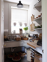 A butler's pantry is located in a side room adjoining the kitchen