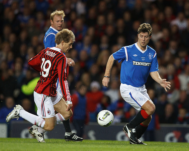 Brian Laudrup glides past Roberto Mussi
