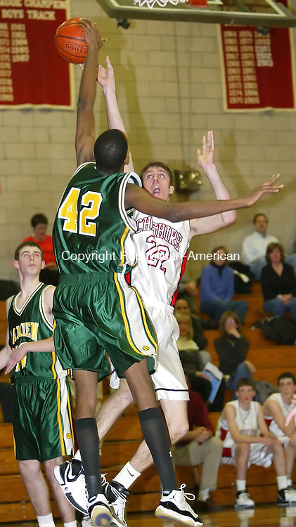 CHESHIRE, CT, 01/16/07- 011607BZ19- Cheshire's     Dave Havliceck (22) is blocked by Hamden's Marques Reddick-Dixon (42) on his way to the hoop<br /> during their game at Cheshire High School Tuesday night.<br /> Jamison C. Bazinet Republican-American