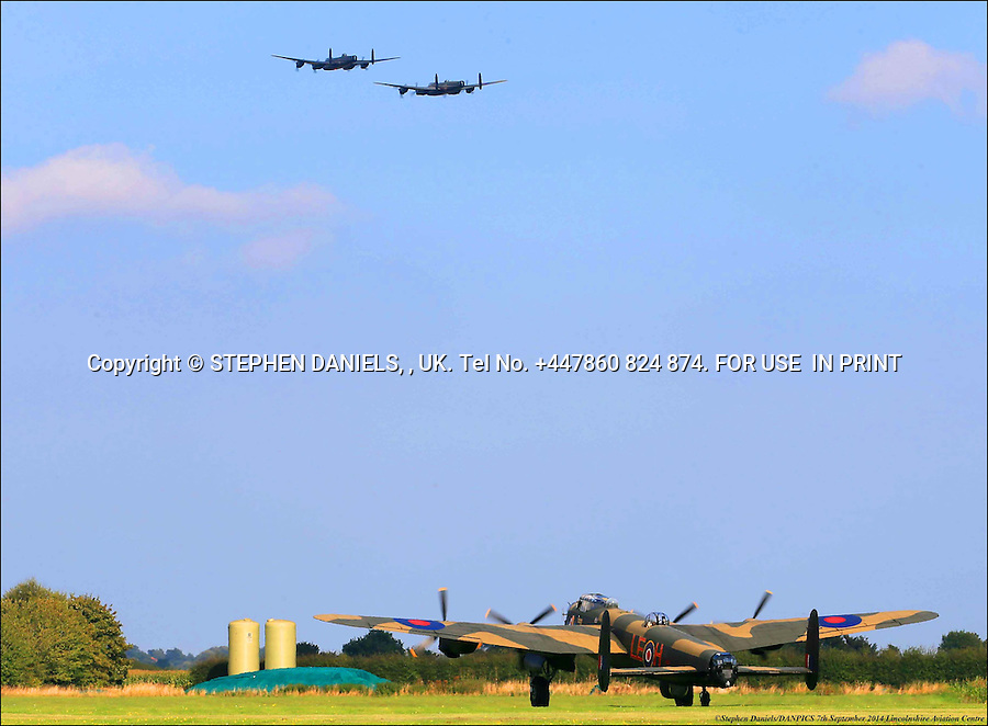 Three Second World War Lancasters together <br />  *NO INTERNET USE PERMITTED*  PRINT MEDIA ONLY<br /> &gt;<br /> DANPIC's; Photo by &copy; Stephen Daniels 07/09/2014 <br /> 3 Second World War Lancaster together for the first time for 50 yrs. RAF Lancaster joined with Canadian Lancaster flew over Panton family Lancaster at Lincs Aviation Heritage Centre, East Kirkby, Nr Boston, Lincs<br /> Minimum Fee &pound;2,000,000.00+vat<br /> &gt;<br /> All images supplied under the terms and condition of <br /> Stephen Daniels and not publication which use them.<br /> All images which is the copyright of Stephen Daniels<br /> and/or DANPICS are supplied under the terms and <br /> condition of Stephen Daniels<br /> &gt;<br /> Words by Medialincs Tel 07933 676119 Richard Vamplew