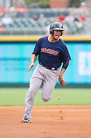 Carlos Rivero (24) of the Pawtucket Red Sox hustles towards third base against the Charlotte Knights at BB&T Ballpark on August 8, 2014 in Charlotte, North Carolina.  The Red Sox defeated the Knights  11-8.  (Brian Westerholt/Four Seam Images)