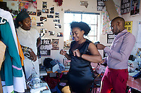 SOWETO, SOUTH AFRICA JULY 3: Lethabo Tsatsinyane, a young designer part of the group Smarteez attends to a customer who came for fittings at his workshop on July 3, 2014 in Jabulani section of Soweto, South Africa. Sibu Sithole one of the other members look watch. Soweto today is a mix of old housing and newly constructed townhouses. A new hungry black middle-class is growing steadily. Many residents work in Johannesburg but the last years many shopping malls have been built, and people are starting to spend their money in Soweto. (Photo by: Per-Anders Pettersson)