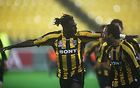 Eugene Dadi celebrates opening the scoring. A-League football - Wellington Phoenix v North Queensland Fury at Westpac Stadium, Wellington. Friday, 15 January 2010. Photo: Dave Lintott / lintottphoto.co.nz.