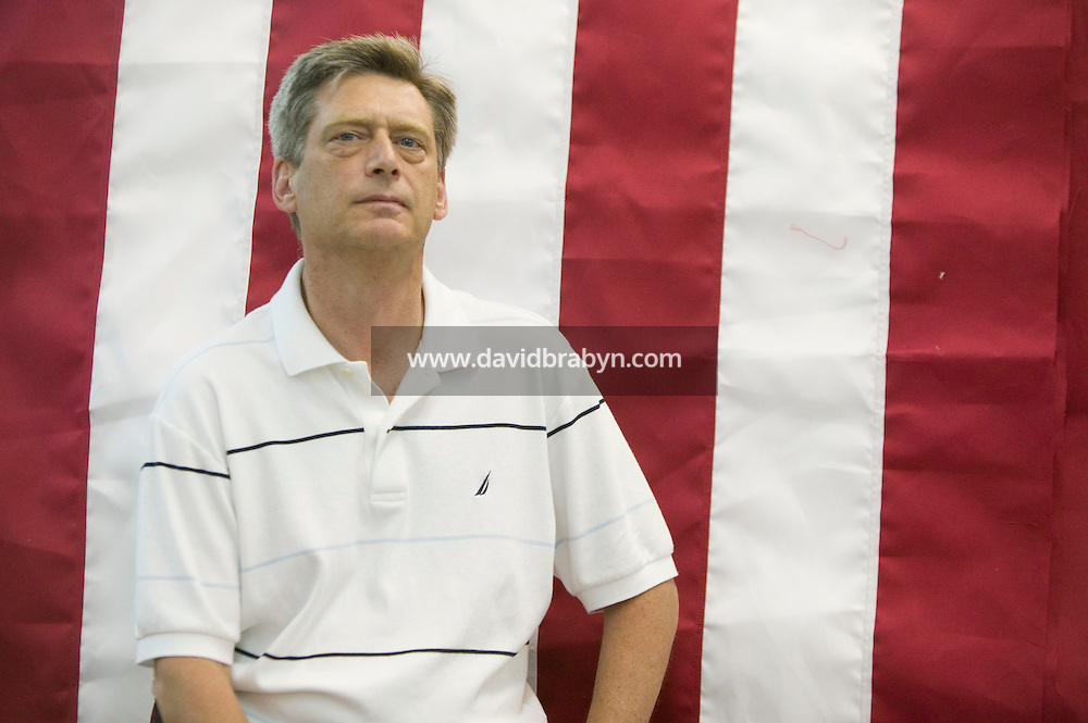 21 June 2005 - Oaks, PA - Dan Dreher, manager of the Annin & Co. American flag manufacturing plant in Oaks, PA, USA, poses in front of a flag. Photo Credit: David Brabyn.