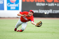 GCL Phillies Andrew Pullin #17 makes a diving catch during a Gulf Coast League game against the GCL Yankees at Legends Field on July 17, 2012 in Tampa, Florida.  GCL Phillies defeated the GCL Yankees 4-2.  (Mike Janes/Four Seam Images)