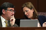 Nevada Sen. Becky Harris, R-Las Vegas, talks with committee counsel Nicolas Anthony during a hearing at the Legislative Building in Carson City, Nev., on Wednesday, April 1, 2015. <br /> Photo by Cathleen Allison