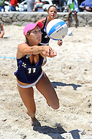 6 April 2013:  FIU's Jessica Mendoza (11) records a dig as the FIU Golden Panthers defeated the Florida Gulf Coast University Eagles, 5-0, to win the Doctor's Hospital FIU South Beach Invitational match at Lummus Park Beach on Miami Beach, Florida.