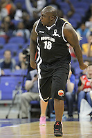 Ade Akinfenwa AFC Wimbledon Footballer celebrates his assist during Hoops Aid 2015 Celebrity AllStars Basketball Match at the o2 Arena, London, England on 10 May 2015. Photo by Andy Rowland.