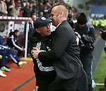 Awkward hug between Tony Pulis manager of West Bromwich Albion and Sean Dyche manager of Burnley - Barclays Premier League - Burnley vs West Bromwich Albion - Turf Moor Stadium  - Burnley - England - 8th February 2015 - Picture Simon Bellis/Sportimage