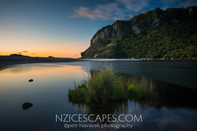 Sunset on beach with Kohaihai River near Karamea, Kahurangi National Park, Buller Region, West Coast, New Zealand