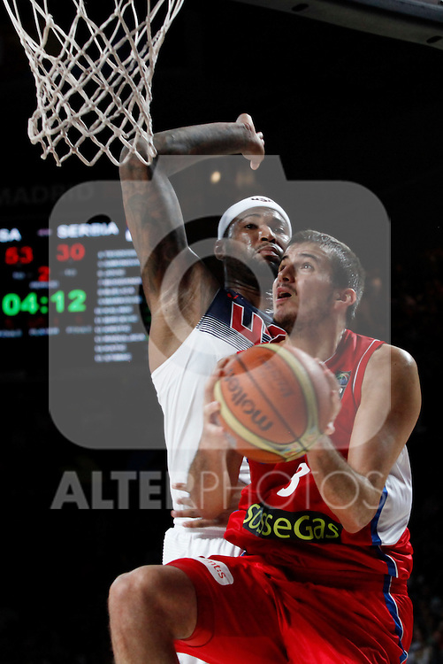 United States´s Cousins  (L) and Serbia´s Bjelica during FIBA Basketball World Cup Spain 2014 final match between United States and Serbia at `Palacio de los deportes´ stadium in Madrid, Spain. September 14, 2014. (ALTERPHOTOSVictor Blanco)