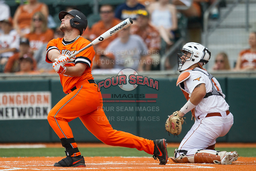 Oklahoma State Cowboys designated hitter Zach Fish #26 follows through on his swing during the NCAA baseball game against the Texas Longhorns on April 26, 2014 at UFCU Disch–Falk Field in Austin, Texas. The Cowboys defeated the Longhorns 2-1. (Andrew Woolley/Four Seam Images)