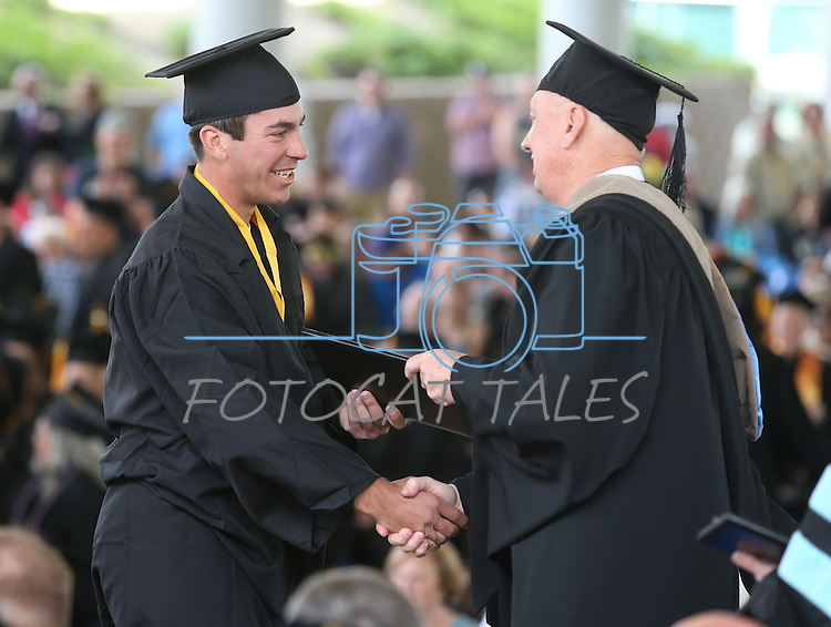 Interim President Chester Burton congratulates Connor Klein during the Western Nevada College commencement at the Pony Express Pavilion, in Carson City, Nev., on Monday, May 19, 2014. <br /> Photo by Cathleen Allison/Nevada Photo Source
