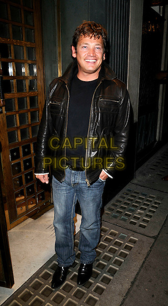 SID OWEN.Celebrity sighting at The Ivy Restaurant, London, England..July 22nd, 2008.full length jeans denim black leather jacket .CAP/CAN.©Can Nguyen/Capital Pictures.