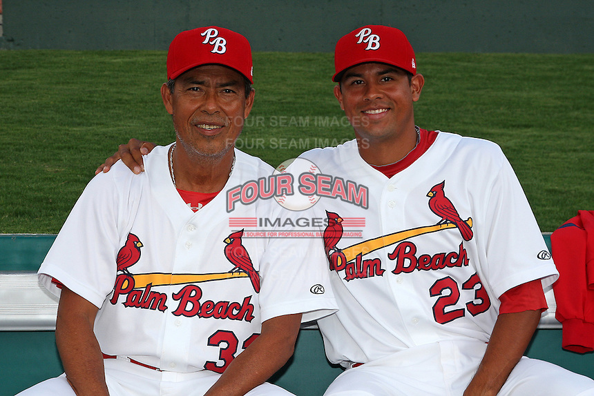 Palm Beach Cardinals pitching coach Dennis Martinez #32 poses for a photo with his son, pitcher Ricky Martinez #23, during a game against the Fort Myers Miracle at Roger Dean Stadium on May 2, 2012 in Jupiter, Florida.  Fort Myers defeated Palm Beach 2-1.  (Mike Janes/Four Seam Images)