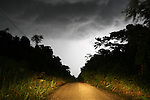 Belize - SEPTEMBER 14, 2007: The road to Machaca Hill from the Southern Highway during a lightning storm on September 14, 2007 in Belize.  (PHOTOGRAPH BY MICHAEL NAGLE)