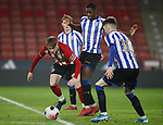 Stephen Mallon of Sheffield Utd tackled by Osaze Urhoghide of Sheffield Wednesday during the Professional Development League match at Bramall Lane, Sheffield. Picture date: 26th November 2019. Picture credit should read: Simon Bellis/Sportimage
