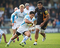 David Lemi of Worcester Warriors in action as Billy Vunipola of London Wasps looks on during the Aviva Premiership match between London Wasps and Worcester Warriors at Adams Park on Sunday 7th October 2012 (Photo by Rob Munro)