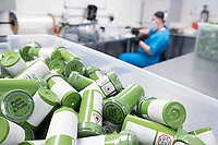 "Dram bottles containing ""g-cap"" gel capsules of cannabis are seen in the packaging department at the production and packaging facility for Garden Remedies, a medical cannabis producer, in Fitchburg, Massachusetts, USA, on Fri., Feb. 22, 2019.  The bottles have a variety of safety labels, including stickers that read ""Not safe for children"" and ""Contains THC"" in addition to other safety features."